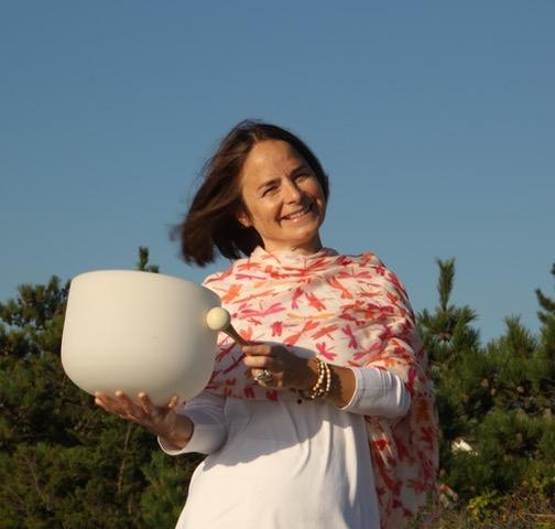 Bettina holding bowl at beach